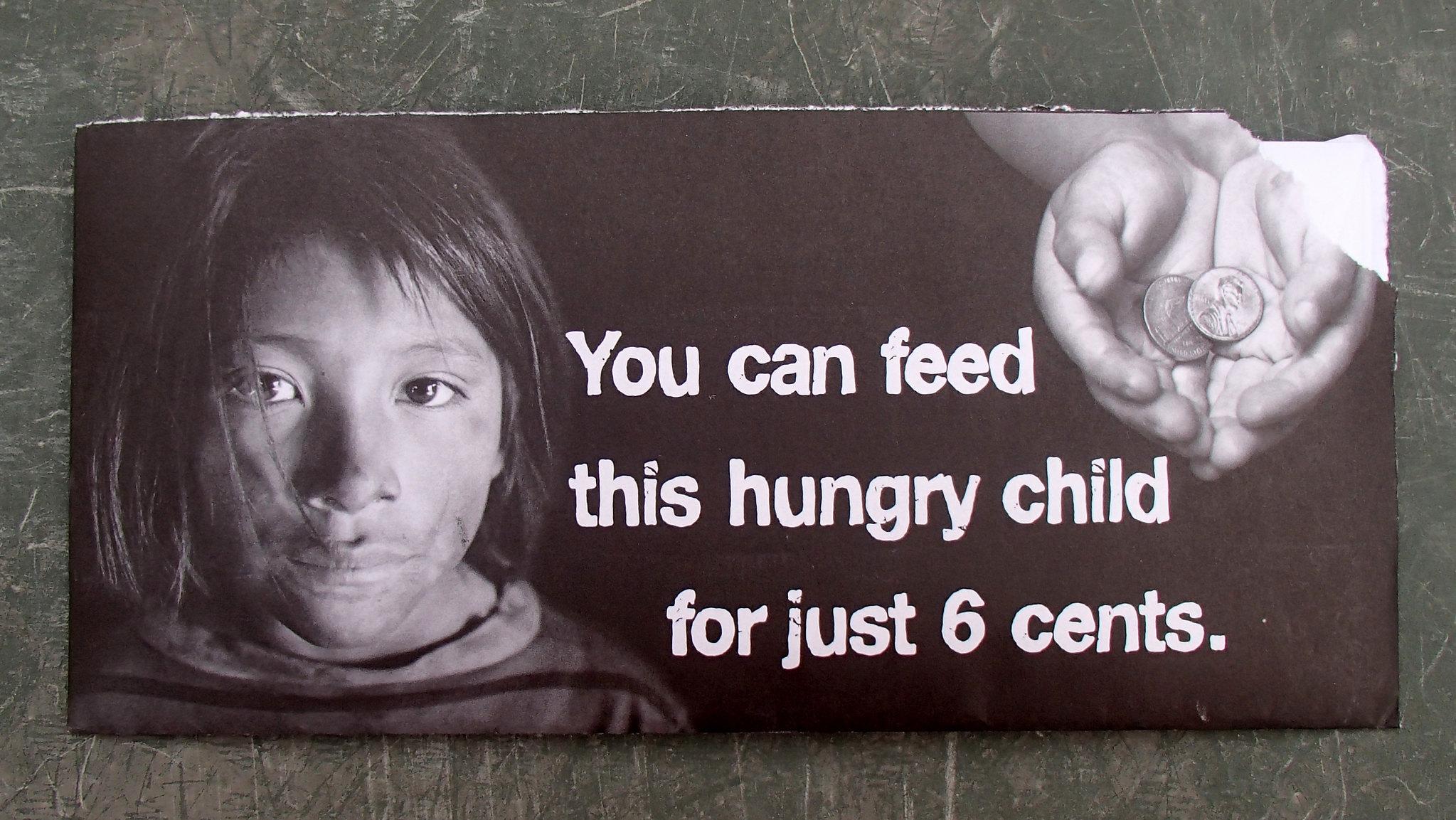 Varainkeruumainos, jossa köyhännäköinen lapsi